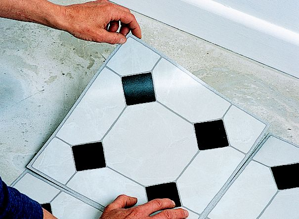 Block top tightly in carpet tiles installation